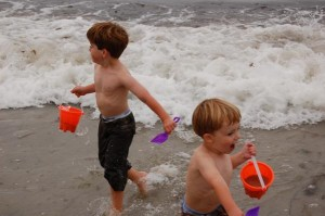 Cooper and Caden running from a wave