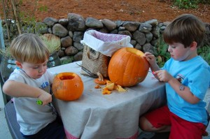 Boys carving pumpkins